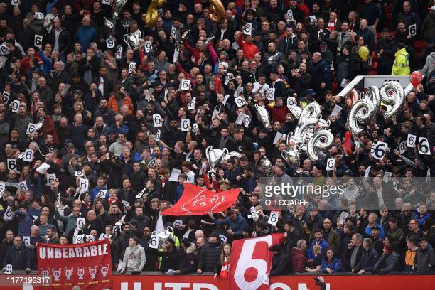 Liverpool fans hold up banners celebrating their six European wins in the crowd ahead of the English Premier League football match between Manchester...