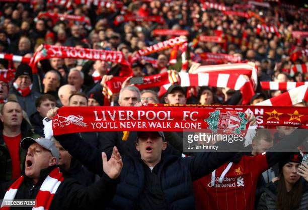 Liverpool fans hold up scarfs prior to the Premier League match between Liverpool FC and Southampton FC at Anfield on February 01 2020 in Liverpool...