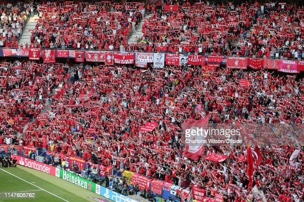 Liverpool fans hold up their scarves as they sing You'll Never Walk Alone ahead of the UEFA Champions League Final between Tottenham Hotspur and...