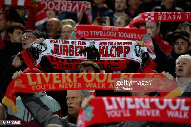 Liverpool fans hold up their scarves during the singing of 'You'll never walk alone' during the UEFA Champions League group E match between Liverpool...