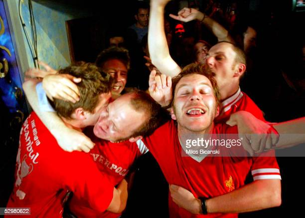 Liverpool fans hug each other after midnight as they celebrate their club's victory against AC Milan in the UEFA Champions League football final...