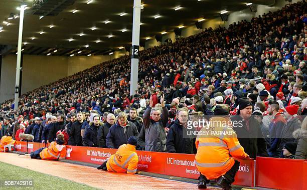 Liverpool fans leave the stands after 77 minutes' of play during the English Premier League football match between Liverpool and Sunderland at...