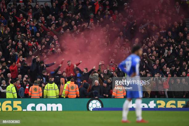 Liverpool fans let off a smoke bomb during the Premier League match between Brighton and Hove Albion and Liverpool at Amex Stadium on December 2 2017...