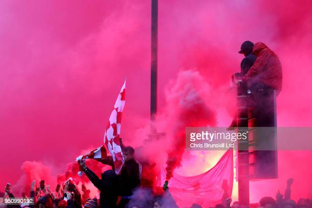 Liverpool fans light flares before the UEFA Champions League Semi Final First Leg match between Liverpool and AS Roma at Anfield on April 24 2018 in...