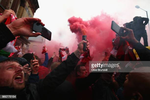 Liverpool fans light flares outside the stadium prior to the UEFA Champions League Semi Final First Leg match between Liverpool and AS Roma at...