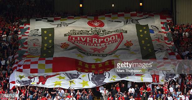 Liverpool fans on the Kop hold up a banner during the Barclays Premier League match between Liverpool and Derby County at Anfield on September 01...
