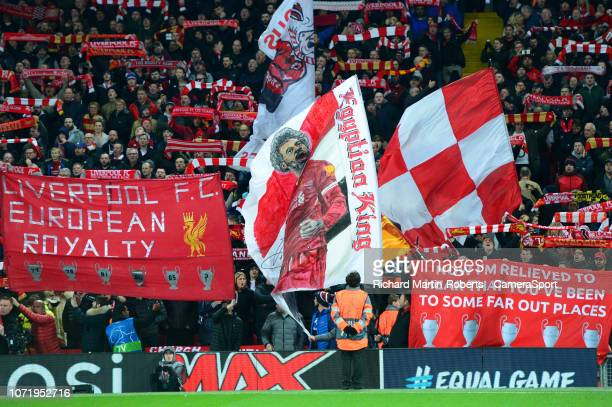 Liverpool fans on the Kop show their support during the UEFA Champions League Group C match between Liverpool and SSC Napoli at Anfield on December...