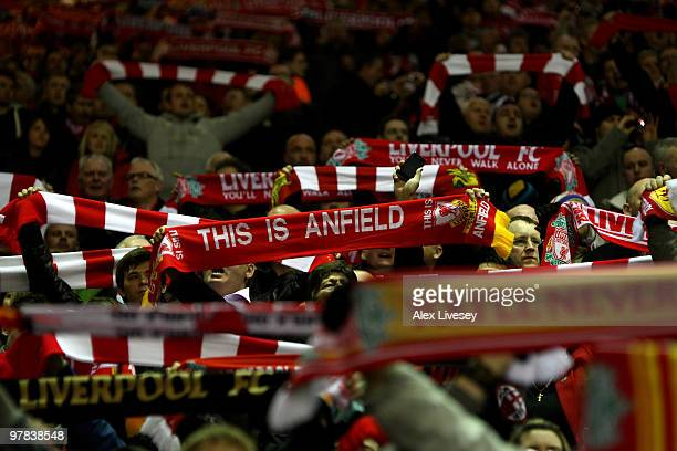 Liverpool fans on the Kop show their support with their scarves during the Barclays Premier League match between Liverpool and Portsmouth at Anfield...