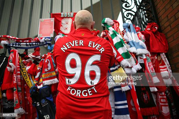Liverpool fans pay their respects at the Hillsborough memorial at Anfield on April 15 Liverpool England Thousands of fans friends and relatives are...