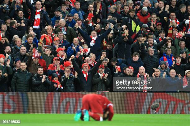 Liverpool fans react as Mohamed Salah of Liverpool celebrates after scoring their 1st goal during the UEFA Champions League Semi Final First Leg...