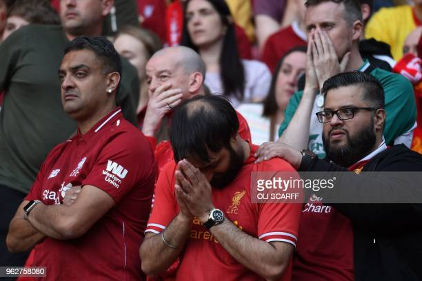 Liverpool fans react as they watch a large screen in Anfield stadium in Liverpool, northern England on May 26, 2018 showing the UEFA Champions League...