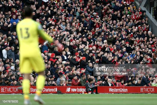LIVERPOOL ENGLAND OCTOBER Liverpool fans react during the first half as goalkeeper Alisson Becker looks on during the Premier League match between...
