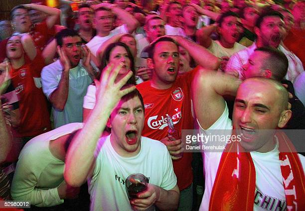 Liverpool fans react to Maldini's goal during the UEFA Champions League match between Liverpool and AC Milan on May 25 2005 in Liverpool England
