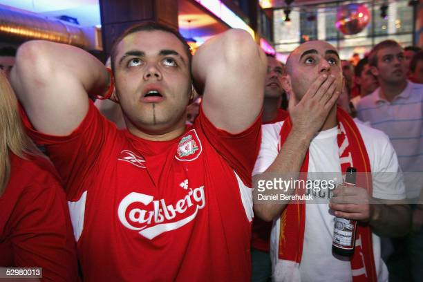 Liverpool fans react whilst watching the during the UEFA Champions League match between Liverpool and AC Milan on May 25 2005 in Liverpool England