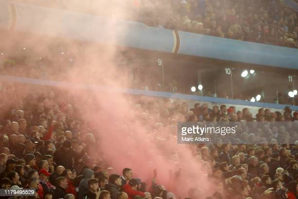 Liverpool fans set iff a smoke bomb as they celebrate during the Premier League match between Aston Villa and Liverpool FC at Villa Park on November...