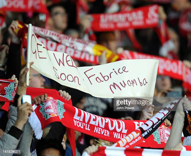 Liverpool fans show support to Fabrice Muamba during the FA Cup Sixth round match between Liverpool and Stoke City at Anfield on March 18 2012 in...