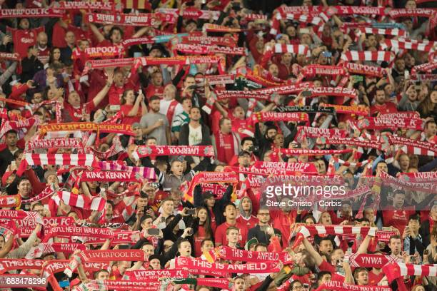 Liverpool fans show their scaffs while singing you'll never walk alone during the International Friendly match between Sydney FC and Liverpool FC at...