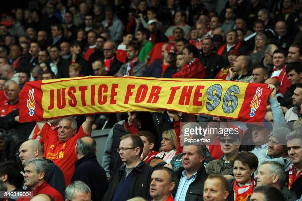 Liverpool fans show their support for the 96 fans who died at Hillsborough in the 1989 disaster during the Barclays Premier League match between...