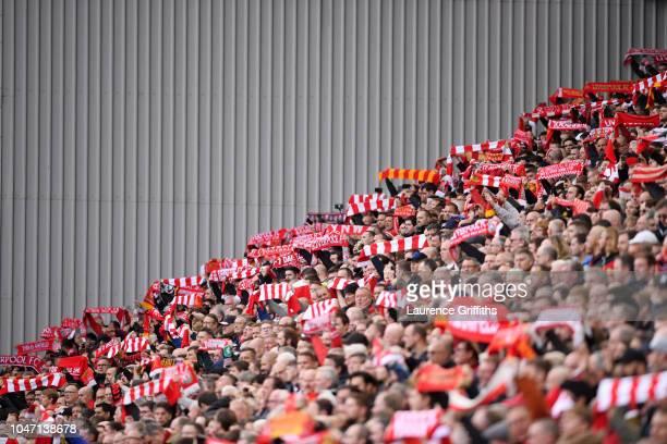 Liverpool fans show their support prior to the Premier League match between Liverpool FC and Manchester City at Anfield on October 7 2018 in...