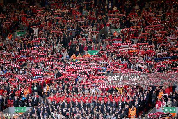 Liverpool fans sing and the Liverpool FC team sing 'You'll Never Walk Alone' during the Hillsborough memorial service marking the 25th anniversary of...