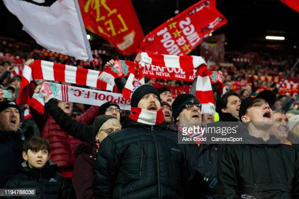 Liverpool fans sing before the Premier League match between Liverpool FC and Manchester United at Anfield on January 19, 2020 in Liverpool, United...