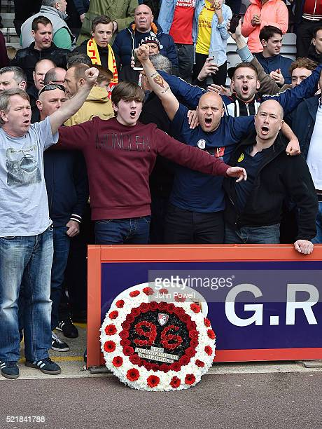 Liverpool fans sing behind the Hillsborough Memorial wreath presented by the two captians Lucas Leiva of Liverpool and Tommy Elphick of AFC...