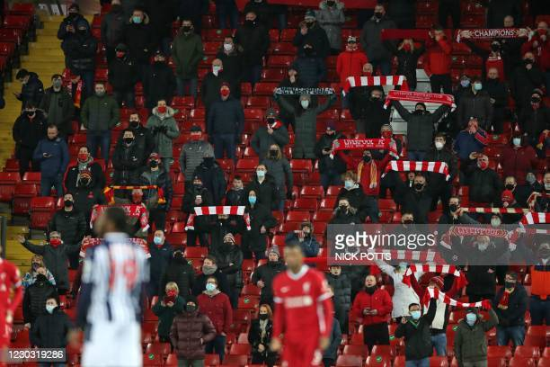 Liverpool fans sing in their socially-distanced seats ahead of the English Premier League football match between Liverpool and West Bromwich Albion...