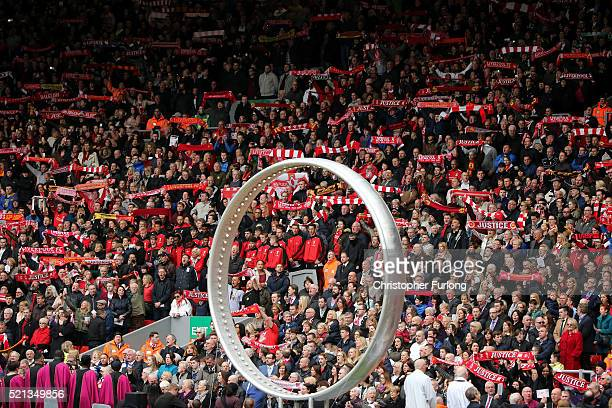 Liverpool fans sing 'You'll Never Walk Alone' alongside the 'Eternal Ring' during a memorial service to mark the 27th anniversary of the Hillsborough...