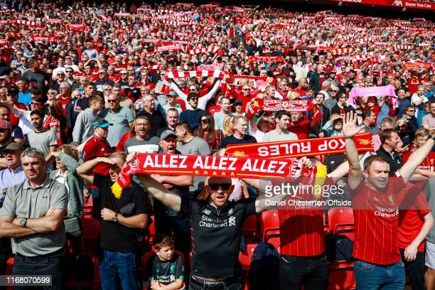 Liverpool fans sing You'll Never Walk Alone before the match during the Premier League match between Liverpool FC and Newcastle United at Anfield on...