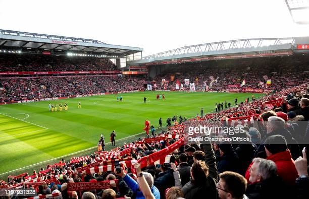 Liverpool fans sing You'll Never Walk Alone before the Premier League match between Liverpool FC and Southampton FC at Anfield on February 1 2020 in...