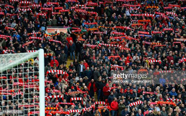 Liverpool fans sing You'll Never Walk Alone prior to the match during the Premier League match between Liverpool FC and Huddersfield Town at Anfield...