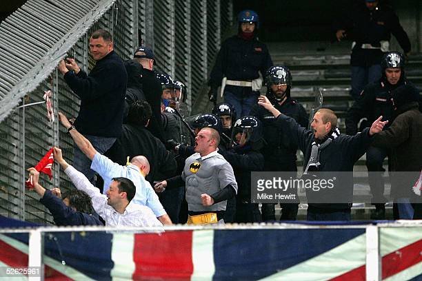 Liverpool fans taunt Juventus fans as the riot police move in before the UEFA Champions League quarterfinal second leg between Juventus and Liverpool...