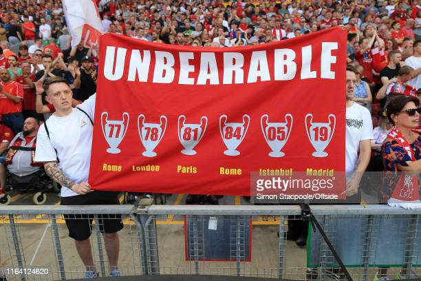 Liverpool fans unveil a banner declaring themselves 'Unbearable' along with their 6 European Cup triumphs during the Premier League match between...