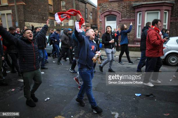 Liverpool fans walk through the streets ahead of the UEFA Champions League Quarter Final First Leg match between Liverpool and Manchester City at...