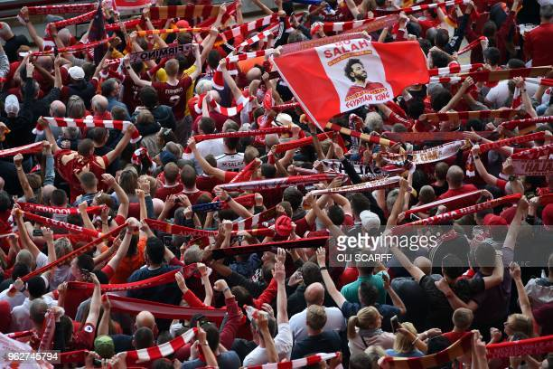 TOPSHOT Liverpool fans watch a large screen in Anfield stadium in Liverpool northern England on May 26 2018 showing the UEFA Champions League final...