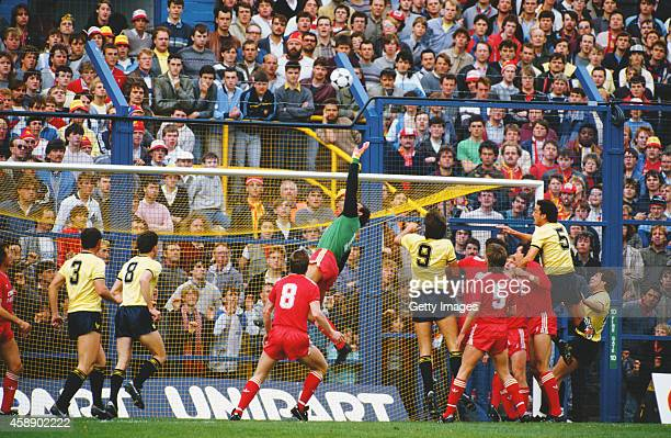 Liverpool fans watch the goalmouth action on the terraces from behind the safety fences from a League Division One match between Oxford United and...