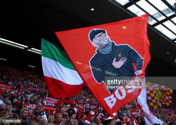 Liverpool fans wave banners ahead of the Premier League match between Liverpool FC and Arsenal FC at Anfield on August 24 2019 in Liverpool United...