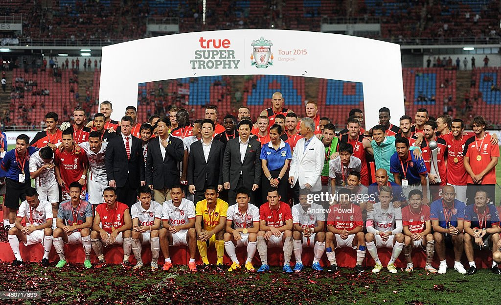 Liverpool FC and Thai Premier League All Stars pose for a photo at the end of the international friendly match between Thai Premier League All Stars and Liverpool FC at Rajamangala Stadium on July 14, 2015 in Bangkok, Thailand.
