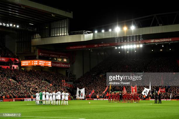 Liverpool FC and West Ham United players paying their respect to Brain Jackson former Liverpool player with a minutes round of applause before the...