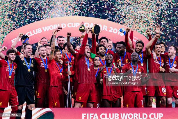 Liverpool FC celebrating with his trophy of champions during the FIFA Club World Cup Final match between Liverpool FC and CR Flamengo at Khalifa...