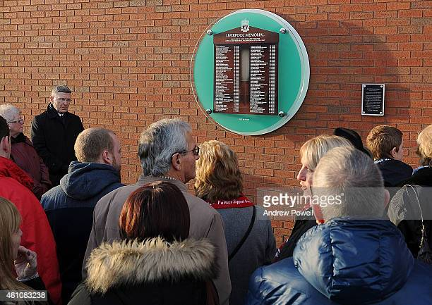 Liverpool FC chaplain Bill Bygroves unveils a new temporary Hillsborough memorial on the Centenary Stand as the existing memorial heads into storage...