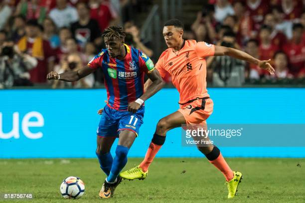 Liverpool FC defender Trent AlexanderArnold fights for the ball with Crystal Palace midfielder Wilfried Zaha during the Premier League Asia Trophy...