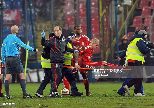 Liverpool FC doctor talks to the referee after Martin Skrtel is stretcherd off during the UEFA Europa League knock-out round, second leg match...