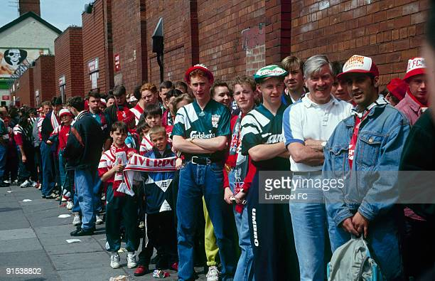 Liverpool FC fans line up to gain entry onto the Spion Kop stand Anfield for the very last time to watch a football match during the FA Carling...