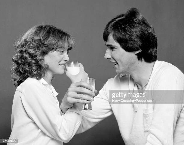 Football Liverpool FC player Alan Hansen is pictured with his Fiance Janet as they make a toast to each other