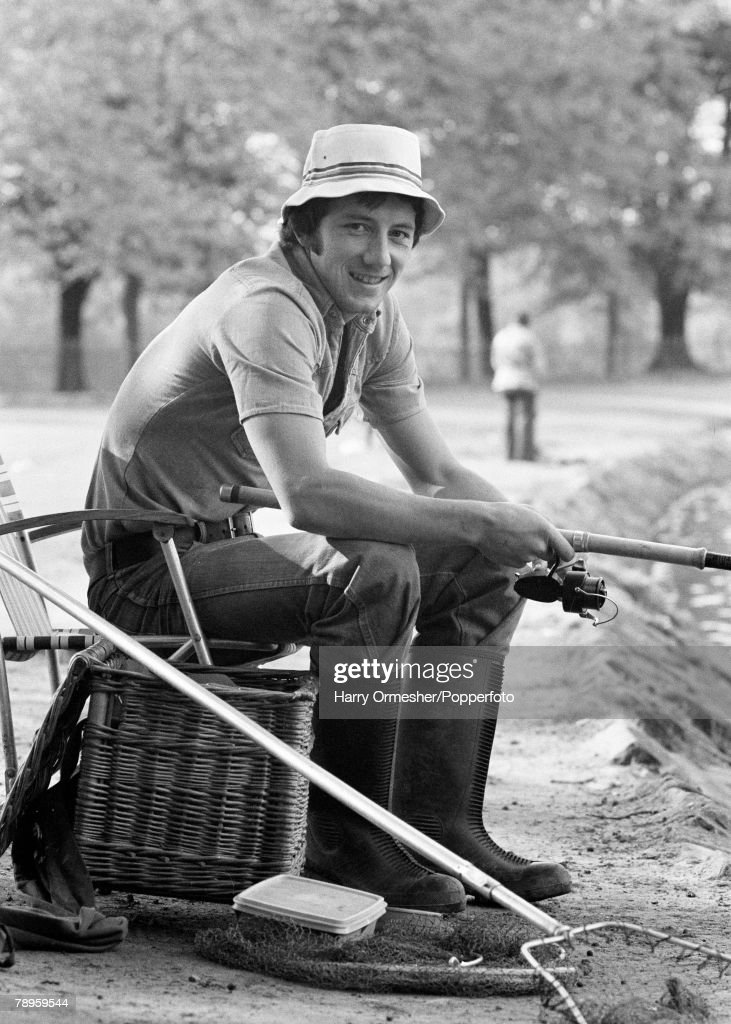 Football. October 1975. Jimmy Case, Liverpool footballer swaps his football kit for a fishing rod during his spare time. : News Photo