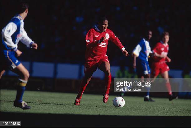 Liverpool FC footballer John Barnes wearing red boots during a Premier League match against Sheffield Wednesday at Hillsborough Stadium, Sheffield,...