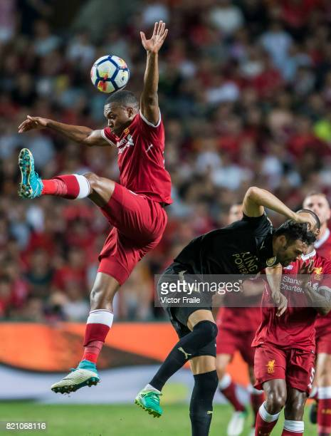 Liverpool FC forward Daniel Sturridge fights for the ball with Leicester City FC midfielder Vicente Iborra during the Premier League Asia Trophy...