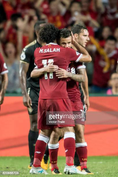 Liverpool FC forward Mohamed Salah celebrates with teammate Philippe Coutinho during the Premier League Asia Trophy match between Liverpool FC and...