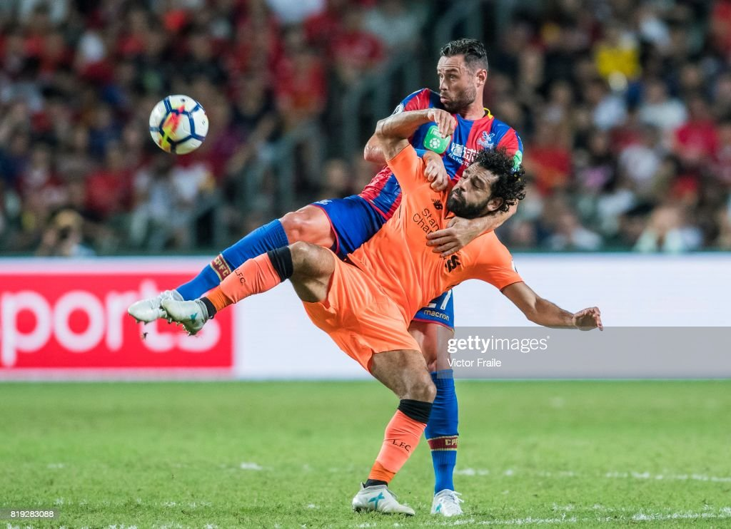 Liverpool FC forward Mohamed Salah (front) fights for the ball with Crystal Palace defender Damien Delaney (back) during the Premier League Asia Trophy match between Liverpool FC and Crystal Palace FC at Hong Kong Stadium on July 19, 2017 in Hong Kong, Hong Kong.